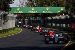 Lewis Hamilton, Mercedes AMG F1 W08, leads Sebastian Vettel, Ferrari SF70H, Valtteri Bottas, Mercedes AMG F1 W08, and the rest of the field