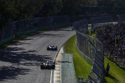 Esteban Ocon, Force India VJM10, leads Nico Hulkenberg, Renault Sport F1 Team RS17