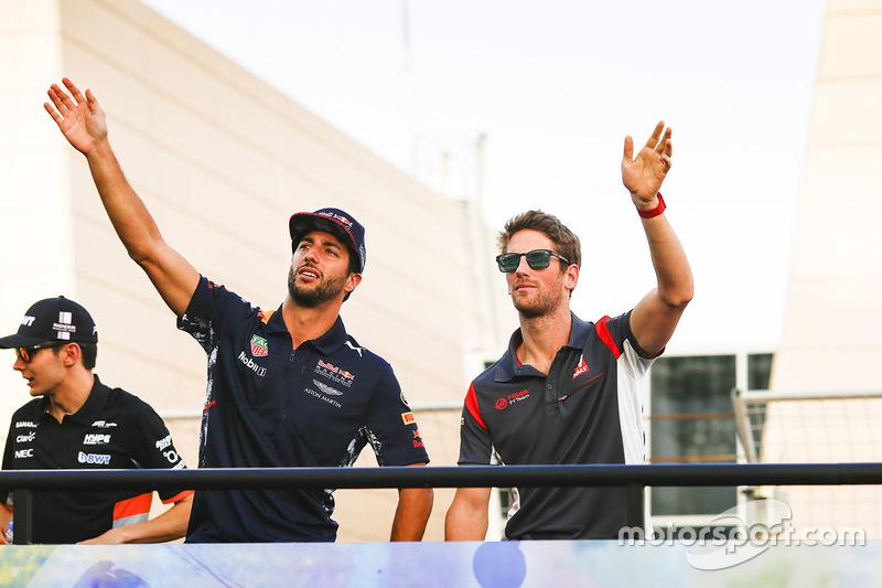 Daniel Ricciardo, Red Bull Racing, and Romain Grosjean, Haas F1 Team