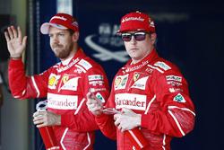 Обладатель поул-позиции Себастьян Феттель, Ferrari, второе место – Кими Райкконен, Ferrari