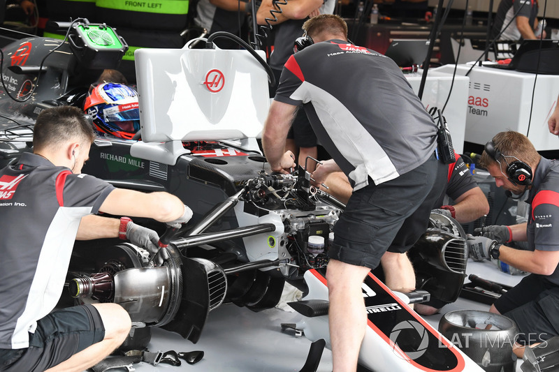 Haas F1 mechanics work on the Haas F1 Team VF-17 or Romain Grosjean, Haas F1