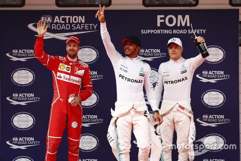 Top three qualifiers Lewis Hamilton, Mercedes AMG, Sebastian Vettel, Ferrari, and Valtteri Bottas, Mercedes AMG