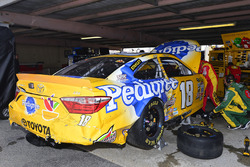 Crew members work on the crashed car of Kyle Busch, Joe Gibbs Racing Toyota