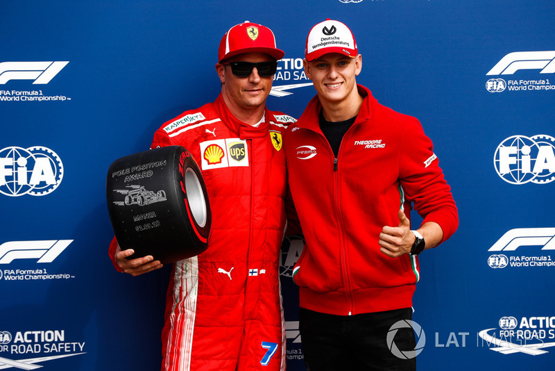 Mick Schumacher presents Kimi Raikkonen, Ferrari, with the Pirelli Pole Position award