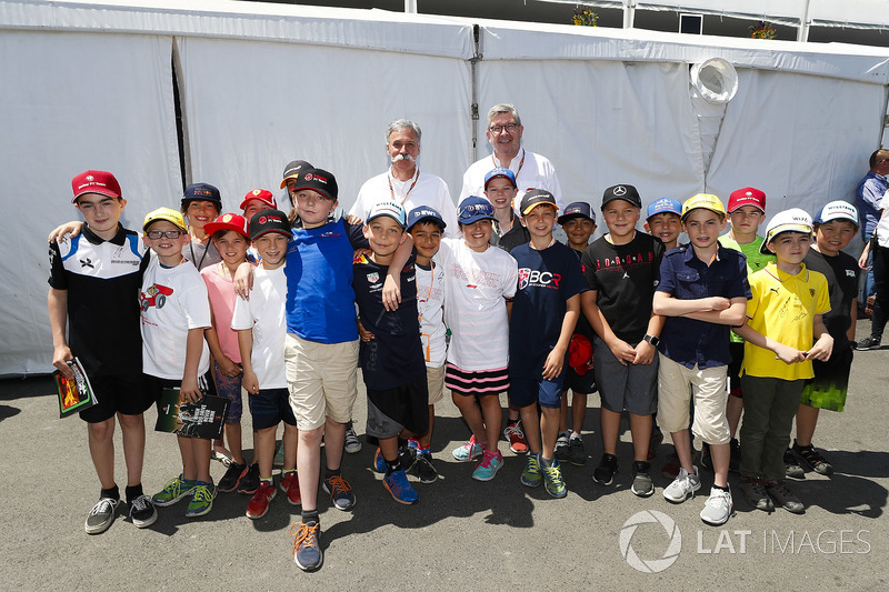 Chase Carey, Chairman, Formula One, and Ross Brawn, Managing Director of Motorsports, FOM, meet some of the grid kid mascots for the race