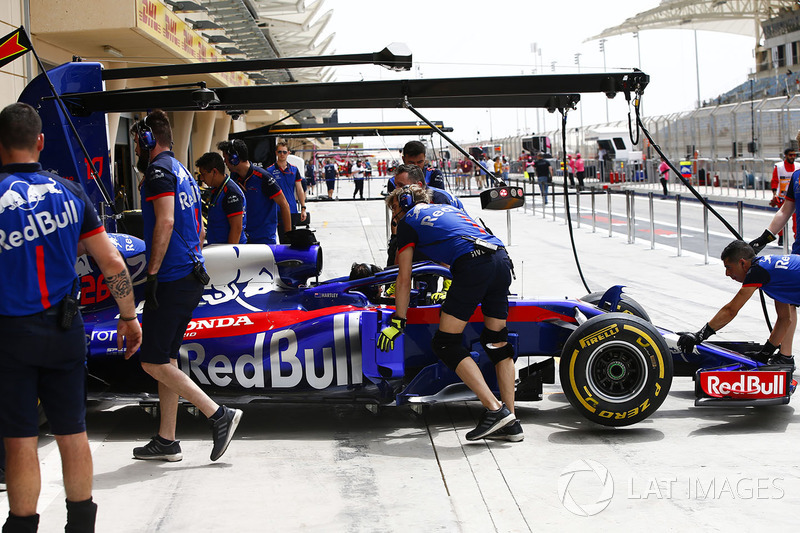Car of Brendon Hartley, Toro Rosso STR13 Honda, being pushed back into the garage