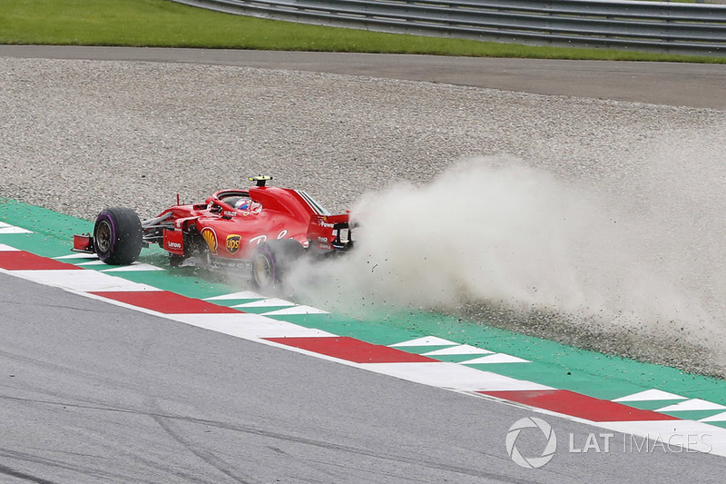 Kimi Raikkonen, Ferrari SF71H, runs wide through a gravel trap, kicking up dust and stones
