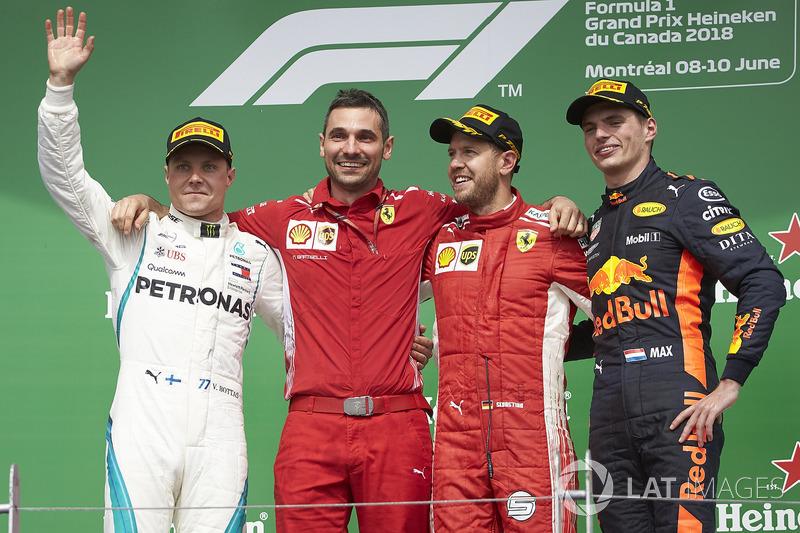 Valtteri Bottas, Mercedes AMG F1, Nicola Bariselli, Race Engineer, Ferrari, Sebastian Vettel, Ferrari, 1st position, and Max Verstappen, Red Bull Racing, 3rd position, on the podium
