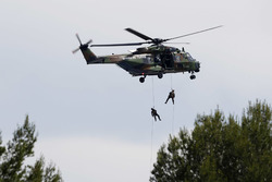 Pre-race entertainment as soldiers abseil from a helicopter