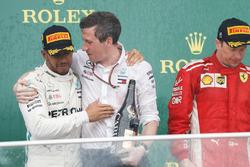 Lewis Hamilton, Mercedes AMG F1, 1st position, celebrates with the Mercedes Constructors trophy delegate alongside Kimi Raikkonen, Ferrari, 2nd position, on the podium