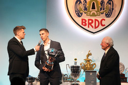 Paddy Hopkirk presents the Graham Hill Trophy to Harrison Scott