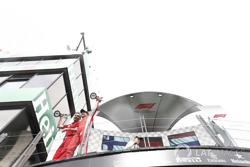 Sebastian Vettel, Ferrari, 1st position, leaves the podium with his trophy