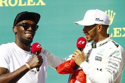 Usain Bolt with winner Lewis Hamilton, Mercedes AMG F1, on the podium