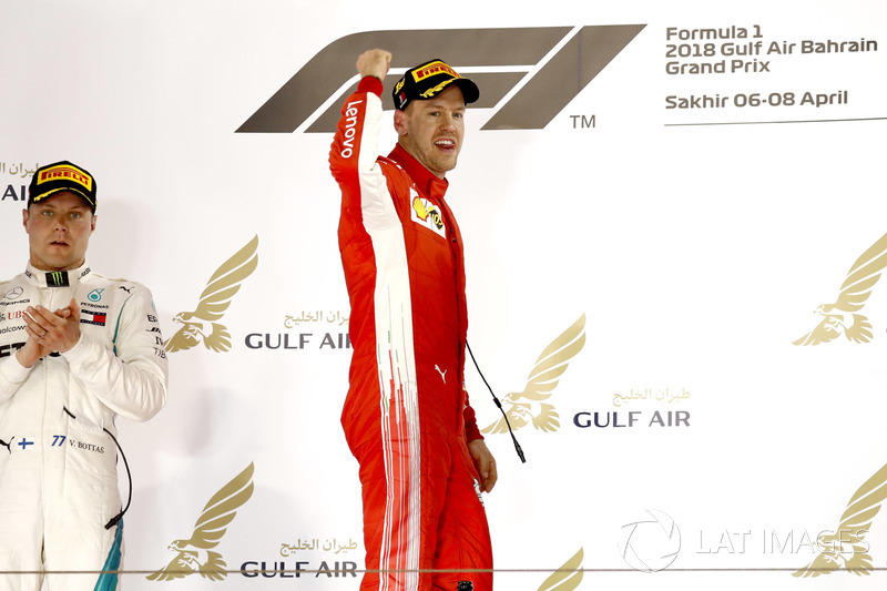 Valtteri Bottas, Mercedes AMG F1, 2nd position, applauds as Sebastian Vettel, Ferrari, 1st position,