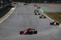 Kimi Raikkonen, Ferrari SF71H, leads Daniel Ricciardo, Red Bull Racing RB14, and Nico Hulkenberg, Renault Sport F1 Team R.S. 18