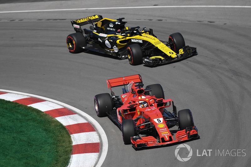 Себастьян Феттель, Ferrari SF71H, та Ніко Хюлькенберг, Renault Sport F1 Team R.S. 18