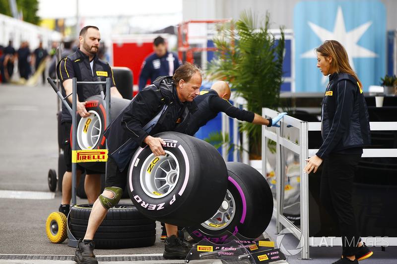 Pirelli personnel unload tyres in the paddock