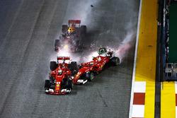 Sparks fly as Kimi Raikkonen, Ferrari SF70H hits Max Verstappen, Red Bull Racing RB13 and Sebastian Vettel, Ferrari SF70H