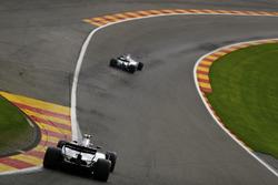 Lance Stroll, Williams FW40, follows Felipe Massa, Williams FW40, through Eau Rouge
