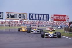 Nelson Piquet, Williams FW11B Honda, leads Nigel Mansell, Williams FW11B Honda and Ayrton Senna, Team Lotus Honda 99T