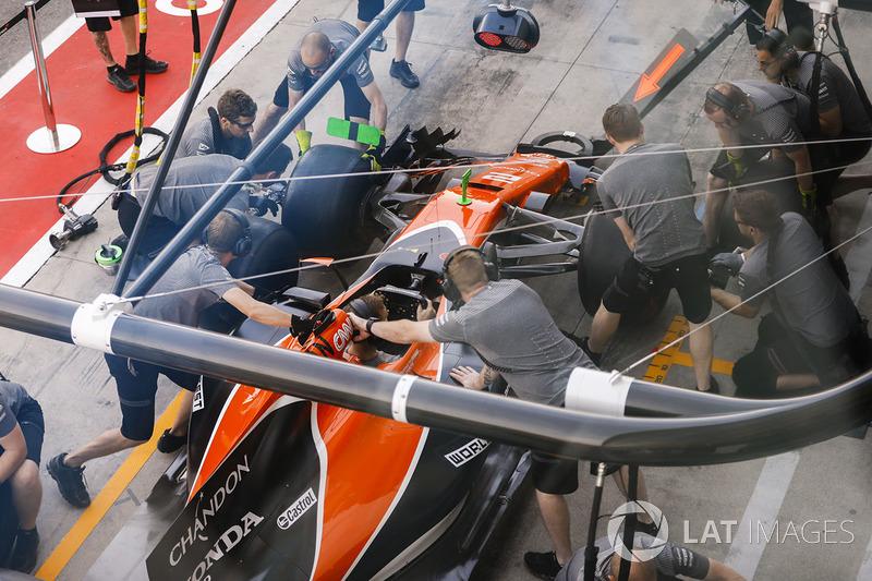 The McLaren team practice pit stops