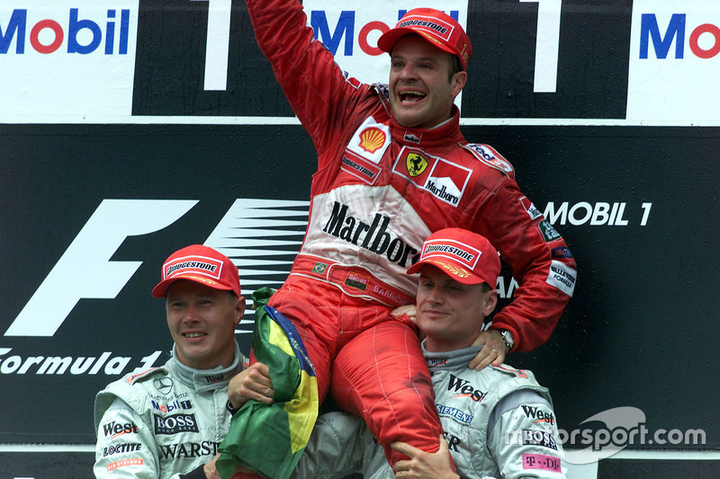 Podium: Race winner Rubens Barrichello, Ferrari, second place Mika Hakkinen, McLaren Mercedes, third place David Coulthard, McLaren Mercedes