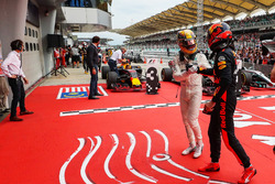 Lewis Hamilton, Mercedes AMG F1 and race winner Max Verstappen, Red Bull Racing celebrate in parc ferme