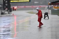 Jock Clear, Ferrari Chief Engineer in wet pit lane