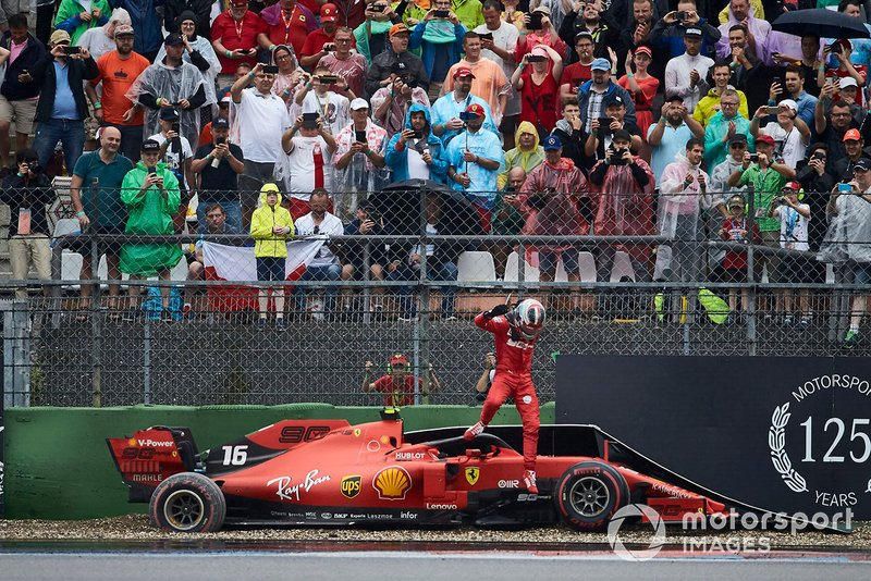 Charles Leclerc, Ferrari, climbs out of his damaged car