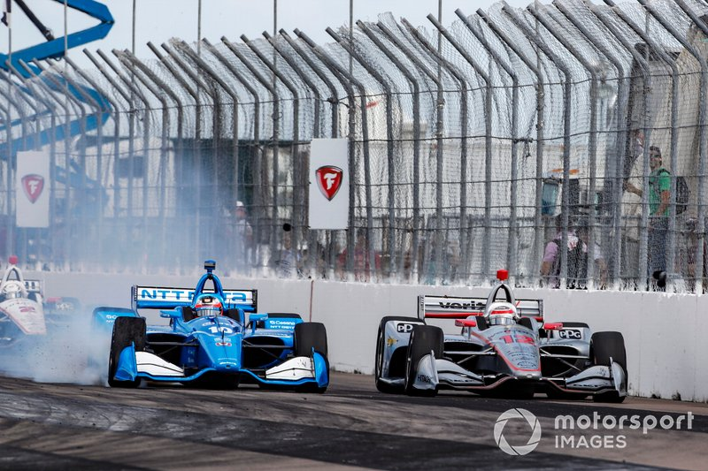 Felix Rosenqvist's Ganassi-Honda passes Will Power's Penske-Chevrolet to take the lead following a restart at St. Petersburg.