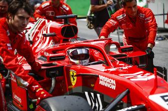 Sebastian Vettel, Ferrari, is pushed onto the grid.