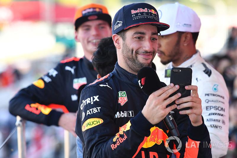 Daniel Ricciardo, Red Bull Racing celebrates with his phone on the podium