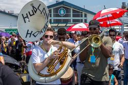 Hudson Horns perform on the grid