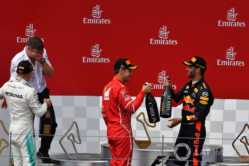 Sebastian Vettel, Ferrari, Valtteri Bottas, Mercedes AMG F1, Daniel Ricciardo, Red Bull Racing celebrate on the podium, the champagne