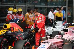 Sebastian Vettel, Ferrari, examines a Red Bull Racing RB13 in parc ferme