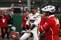 Jenson Button, McLaren, Marc Gene of Ferrari sit astride bicycles
