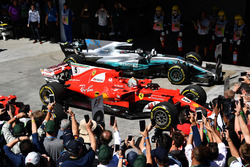 Race winner Sebastian Vettel, Ferrari SF70H and second place Valtteri Bottas, Mercedes-Benz F1 W08  in parc ferme