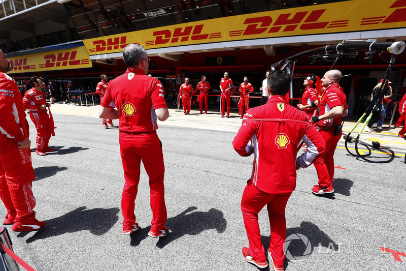 Ferrari team members limber up before the race