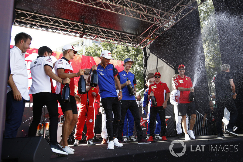 Charles Leclerc, Alfa Romeo Sauber F1 Team, Marcus Ericsson, Alfa Romeo Sauber F1 Team, Pierre Gasly, Scuderia Toro Rosso Toro Rosso, Brendon Hartley, Scuderia Toro Rosso and Sebastian Vettel, Ferrari spray the champagne on stage