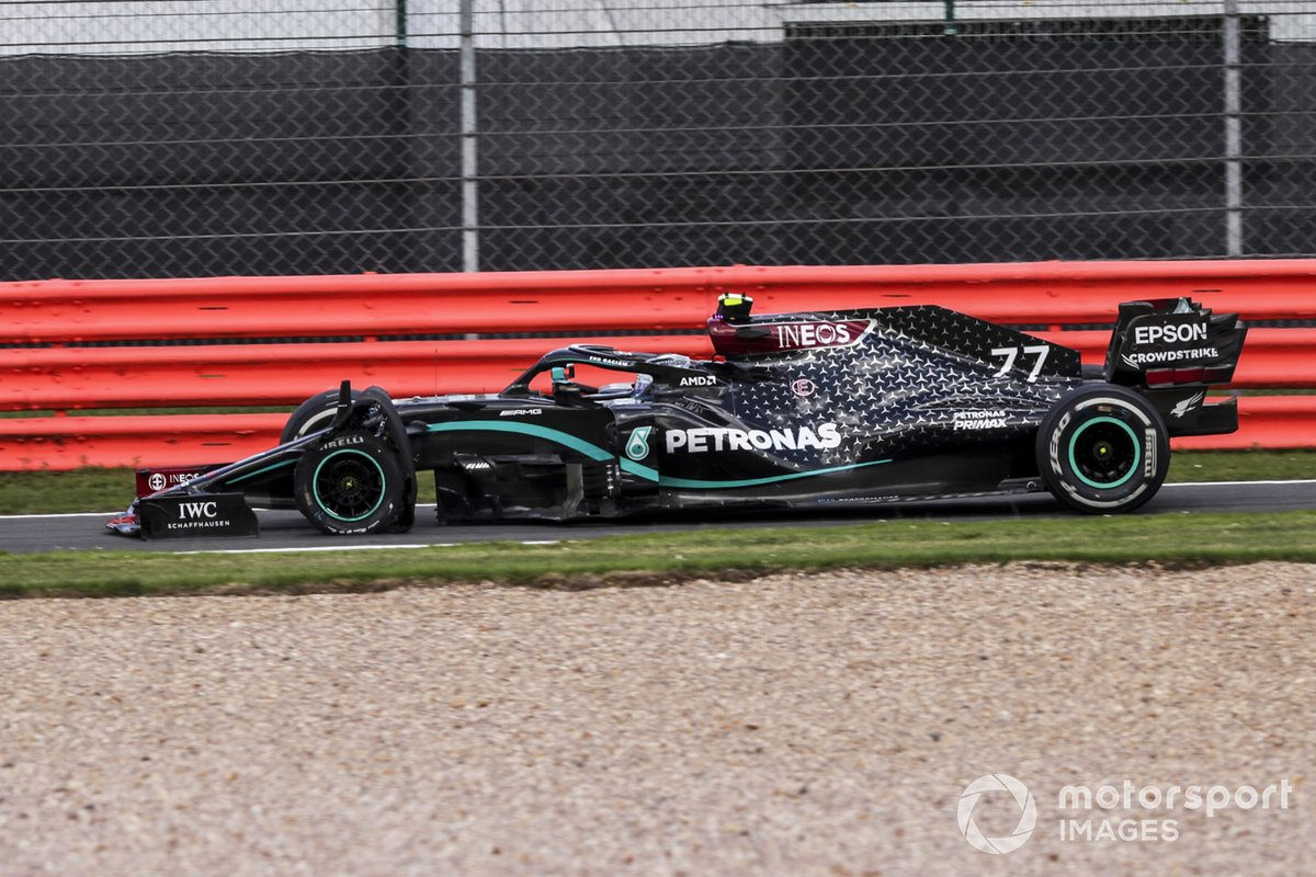 Valtteri Bottas, Mercedes F1 W11 coming into pit with a puncture