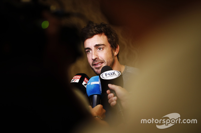 Fernando Alonso talks to the media after announcing his deal to race in the 2017 Indianapolis 500 in