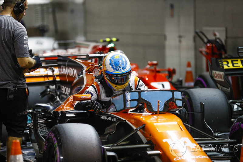 Fernando Alonso, McLaren, climbs out of his car in Parc Ferme