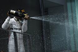 Race winner Lewis Hamilton, Mercedes AMG F1 celebrates on the podium, the champagne