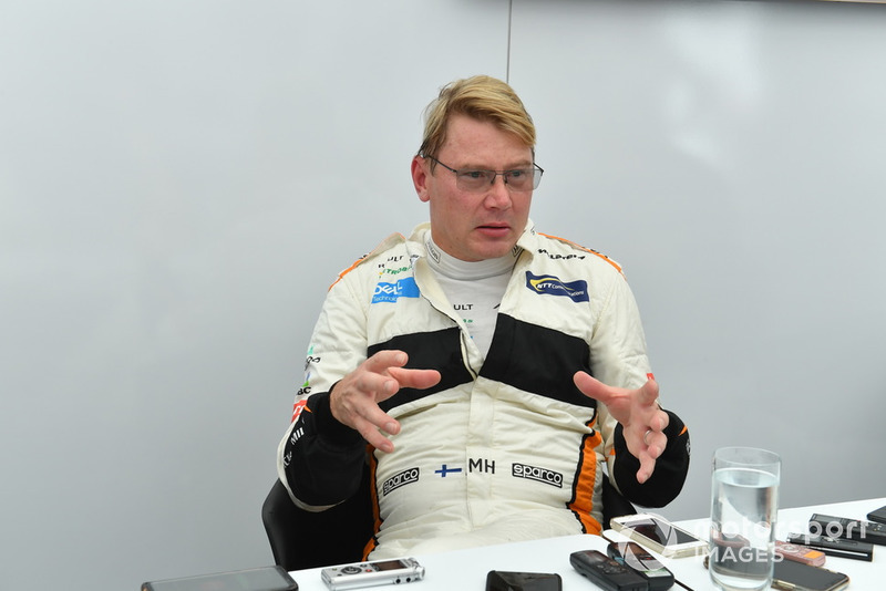 Mika Hakkinen talks with the media at Legends F1 30th Anniversary Lap Demonstration