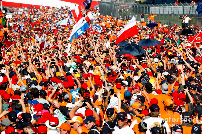 Dutch fans storm the Red Bull Ring to celebrate the victory of Max Verstappen