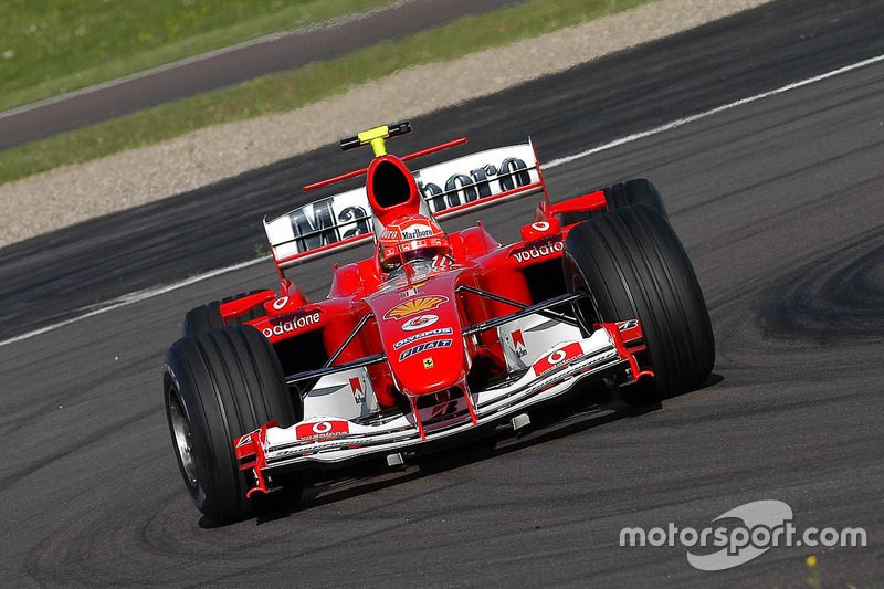 Valentino Rossi, drives the Ferrari F2004, in what was to be a top secret test and he wears one of M