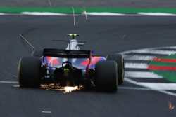 Sparks fly from Carlos Sainz Jr., Scuderia Toro Rosso STR12