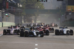 Lewis Hamilton, Mercedes AMG F1 W08, Sebastian Vettel, Ferrari SF70H, is passed by Felipe Massa, Williams FW40, while Sergio Perez, Sahara Force India F1 VJM10, Kimi Raikkonen, Ferrari SF70H and Esteban Ocon, Sahara Force India F1 VJM10, follow