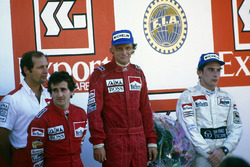 Ron Dennis, Alain Prost, McLaren MP4/2-TAG Porsche, 2nd position, Niki Lauda, McLaren MP4/2-TAG Porsche, 1st position and World Champion, Ayrton Senna, Toleman TG184-Hart, 3rd position, on the podium
