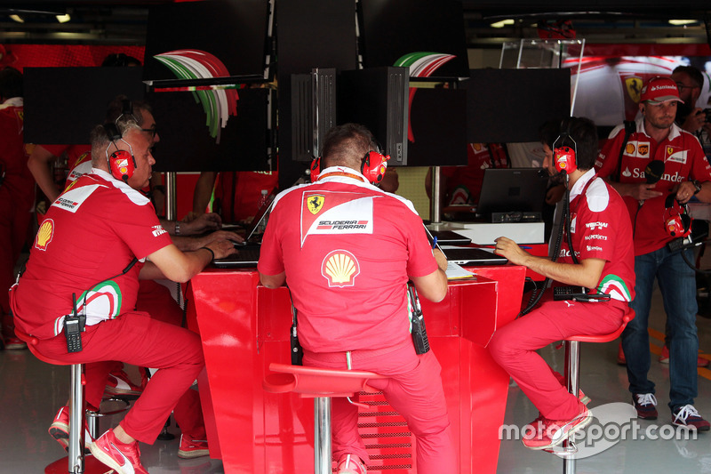 Ferrari engineers in the pit garage central console